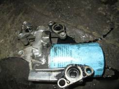 Крепление масляного фильтра Nissan Mistral TD27