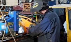 Механик по ремонту экскаватора с выездом на место