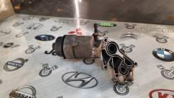 Крепление масляного фильтра Opel Astra GTC A14NET