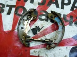 Механизм стояночного тормоза Mazda задний левый