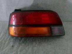 Фонарь (стоп сигнал) Toyota Starlet, левый задний