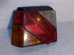 Фонарь (стоп сигнал) Mitsubishi Lancer, левый задний