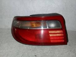 Фонарь (стоп сигнал) Toyota Carina, левый задний