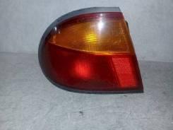 Фонарь (стоп сигнал) Mazda Familia;323, левый задний