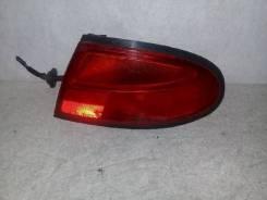 Фонарь (стоп сигнал) Mazda Lantis;323F, правый задний