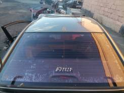 Стекло заднее Kia Cerato 2 / Forte TD 2008-2012