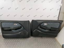 Обшивка двери Nissan Pulsar [809001N200] FN15, передняя