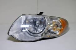 Фара Chrysler Town&Country 2000+ [4857991AB] RS, левая