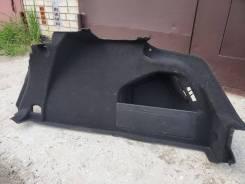 Обшивка багажника правая passat CC